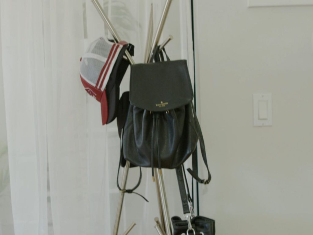 Easy storage tip is hanging bags and hats on coat hangers to free up closet space