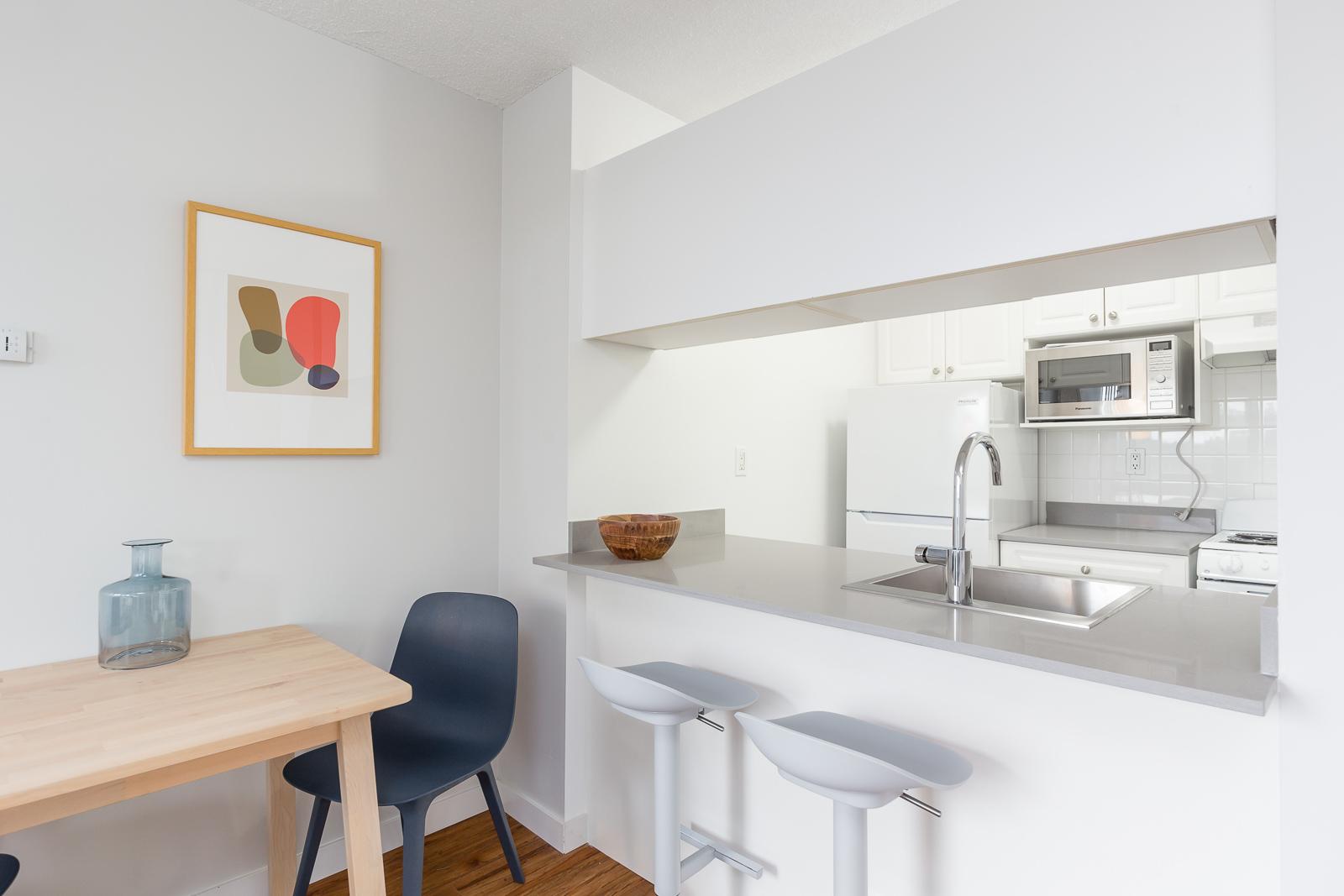 Hollyburn Harbourview 1Bedroom Furnished Rental kitchen dining 2 604